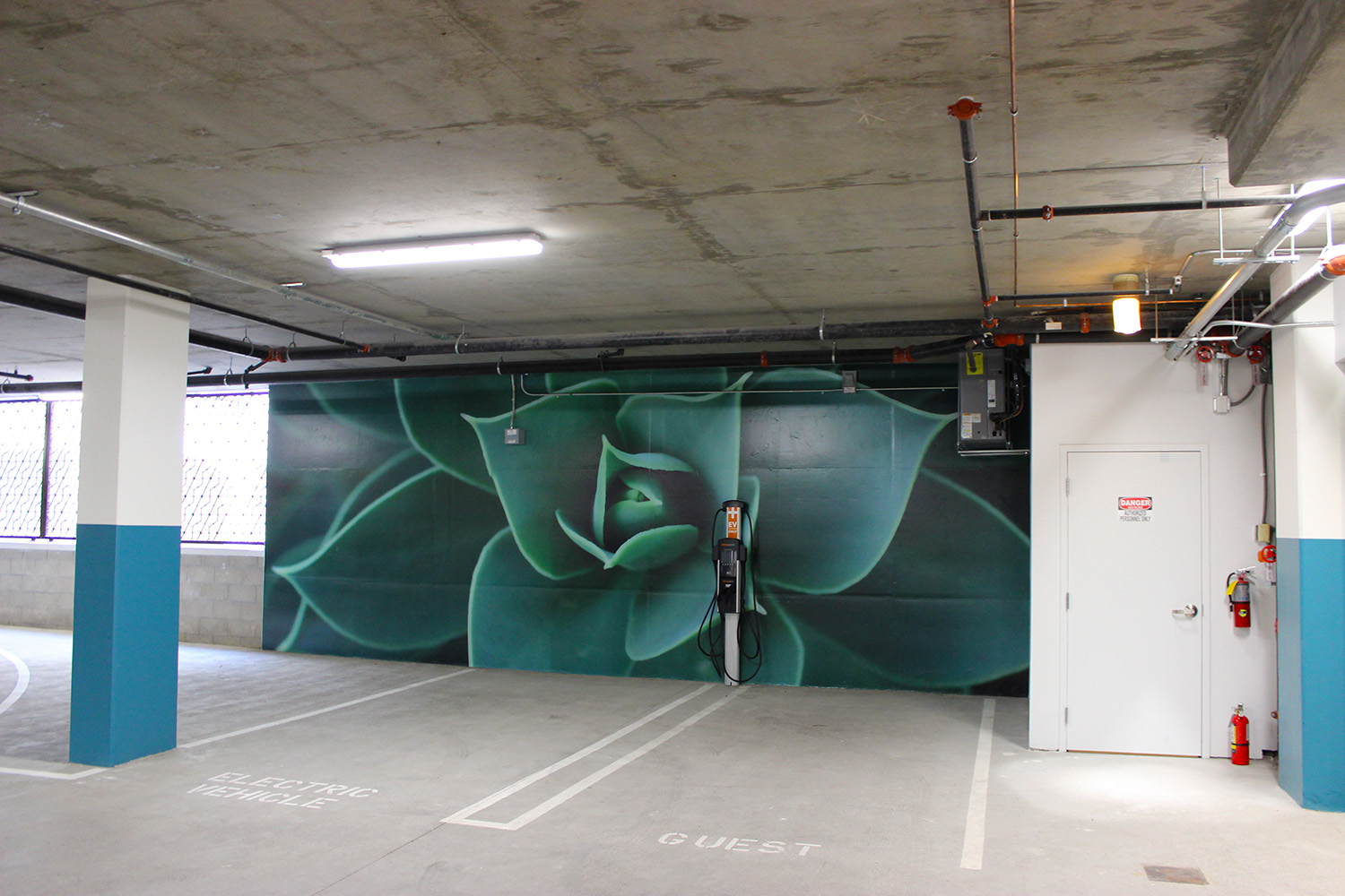 Portable Parking Garage >> Concrete Graphics and Garage Floor Decals